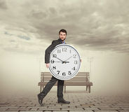 Man holding big clock Royalty Free Stock Photography