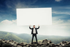 Man holding big empty placard Royalty Free Stock Photography