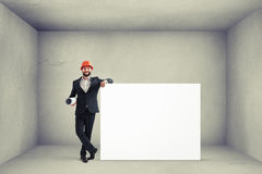 Man holding big empty white banner Royalty Free Stock Photos