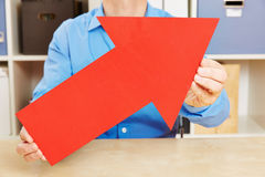 Man holding big red arrow up Stock Image