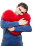 A man holding a big red heart Royalty Free Stock Photos