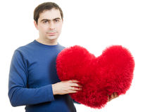 A man holding a big red heart Stock Photos