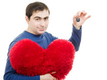 A man holding a big red heart and key Stock Image