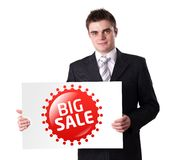 Man Holding BIG SALE sign Stock Image
