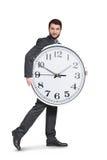 Man holding big white clock Stock Photo