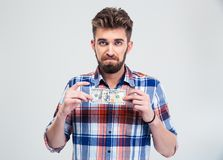 Man holding bill of USA dollar Royalty Free Stock Photography