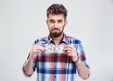 Man holding bill of USA dollar Royalty Free Stock Photography