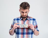 Man holding bill of USA dollar Royalty Free Stock Photo