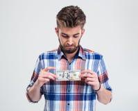 Man holding bill of USA dollar Royalty Free Stock Photo