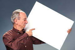 Man holding billboard Stock Image