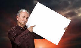 Man holding billboard Stock Images