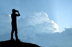 Man holding binocular on sunlight background. S royalty free stock image