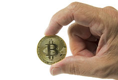 Man holding bitcoin in hand Royalty Free Stock Images