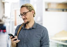 Man Holding Black Android Smartphone While Smiling stock photography