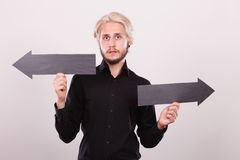 Man holding black arrows pointing left and right Royalty Free Stock Photos