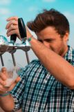 Man Holding Black Beer Tap Handle Pouring Beer on Clear Glass Stock Photo