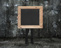 Man holding black blank chalkboard with cityscape doodles mottle Royalty Free Stock Photography