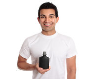 Man holding black bottle or product Stock Photo