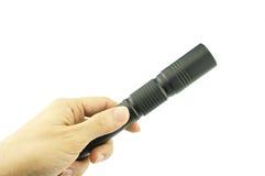 Man holding black flashlight isolated Royalty Free Stock Images