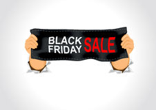 Man holding a black friday sale banner Royalty Free Stock Photo