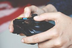 Man Holding Black Game Controller Royalty Free Stock Photo