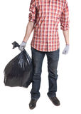 Man holding black plastic trash bag in his hand Royalty Free Stock Image