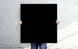 Man holding black poster Stock Photo