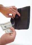 Man holding a black purse and money Stock Photo