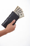 Man holding a black purse with money Stock Image
