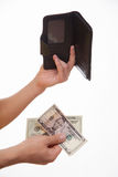 Man holding a black purse and money Stock Image