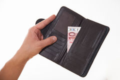 Man holding a black purse with ten euro Royalty Free Stock Photo
