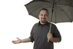 Man holding black umbrella Stock Images
