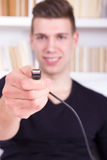Man holding black USB cable Royalty Free Stock Images