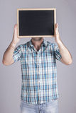Man holding a blackboard Stock Images