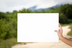 Man holding blank billboard Royalty Free Stock Photo