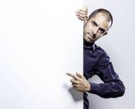 Man holding a blank billboard. Stock Photography