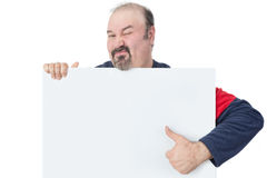 Man holding a blank billboard and giving thumbs-up Royalty Free Stock Photo