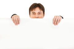 Man holding blank billboard isolated Stock Photography