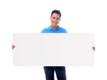 Man holding blank billboard Stock Photo