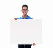 Man holding blank billboard Royalty Free Stock Photography