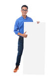 Man holding blank billboard Stock Images