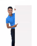 Man holding blank billboard Stock Photography