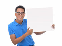 Man holding blank billboard Royalty Free Stock Photos