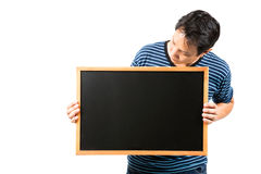 Man holding blank blackboard Royalty Free Stock Photo