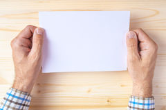 Man holding blank brochure as mock up copy space Royalty Free Stock Photo