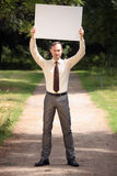 Man holding blank bulletin board Stock Images
