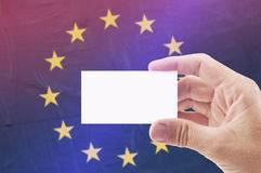 Man Holding Blank Business Card Against European Unionl Flag Royalty Free Stock Photography