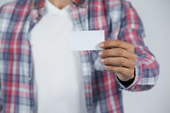 Man holding blank business card Stock Image