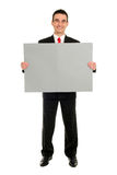 Man Holding Blank Card. Young Businessman Holding Blank Card Royalty Free Stock Photography