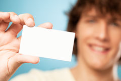 Man Holding a Blank Card Stock Image